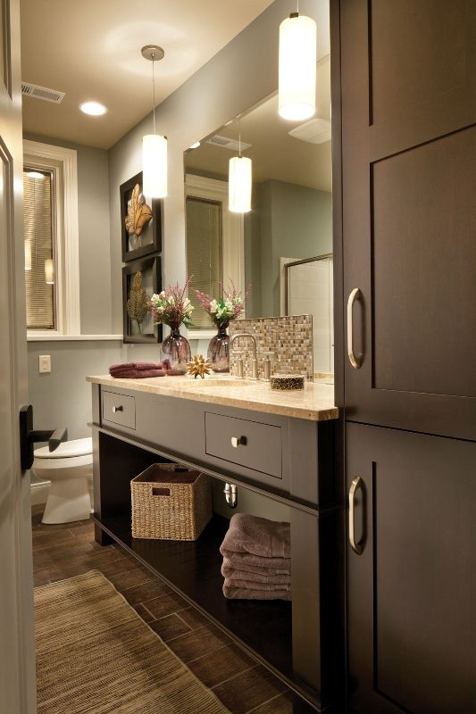 Bathroom vanity with Napa Panel cabinet door style in cherry with cocoa brown finish.
