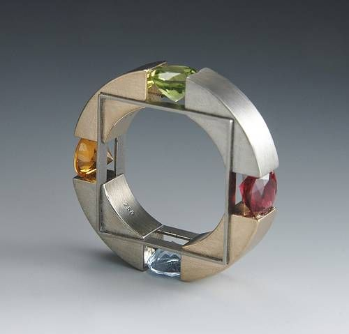 Daniel Chiquet, Switzerland: 'Squaring the Circle';  rose gold, steel, titanium, Cirkonias