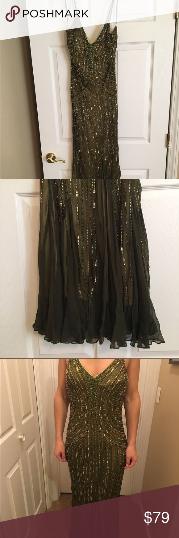 Green sequin evening gown Dark green and gold evening gown. Never been worn, but is missing some beadwork on one strap and has imperfection as depicted in last pic. Make me an offer! Dresses