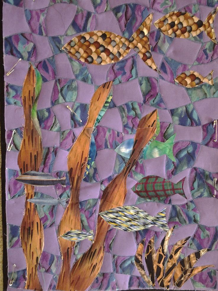 Quilt background design is woven strips of fabric.