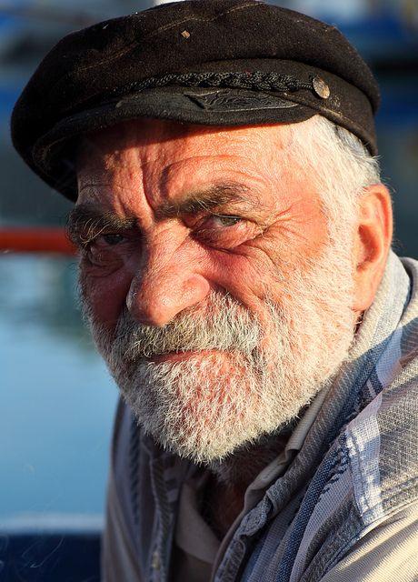 Santorini, Greece  Fisherman, early in the morning in the small harbor in Vlichada, Santorini, Greece