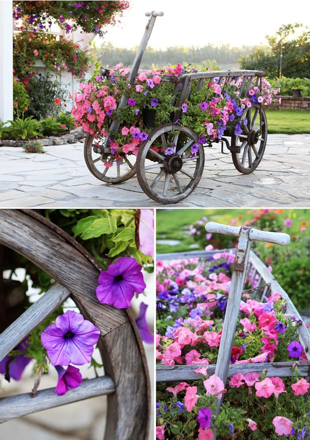Cute little wagon carrying pretty flowers.......love the wagon , flowers and the wheels, everything is just perfect!!