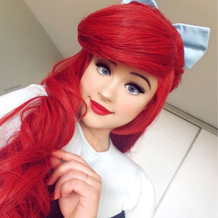 This Little Mermaid makeup is PERFECT! She looks just like Ariel! #halloween #cosplay #disney