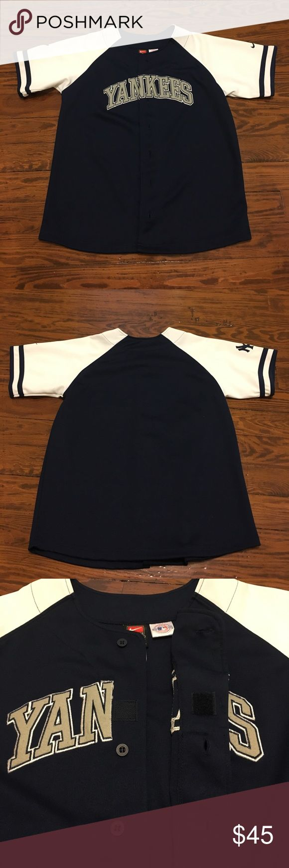 Genuine MLB NY Yankees jersey, mint condition Like new, genuine ML New York Yankees jersey. Classic navy blue & white with grey lettering.  Button closure with one Velcro piece to line up lettering.  Unisex, youth large, worn as woman's small. Major League Shirts & Tops