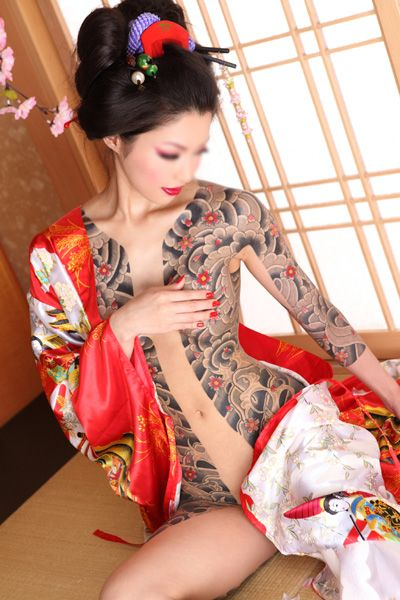 Nanami Asakura in traditional Irezumi tattoo. The fragility of the cherry blossom is the fragility of human existence, its brief period of life, like our own; its movement toward death, indifferent to the good things of this world, is the ideal death for a warrior; and finally, its individual and perfect beauty is also ours. Cherry Blossoms are held in high regard in Japan, emblematic of life's fleeting nature they represent mortality, love, magnificent beauty and sudden death.