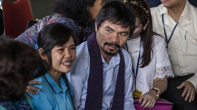 Filipino boxer Manny Pacquiao prays with death-row prisoner in Indonesia | World news | The Guardian