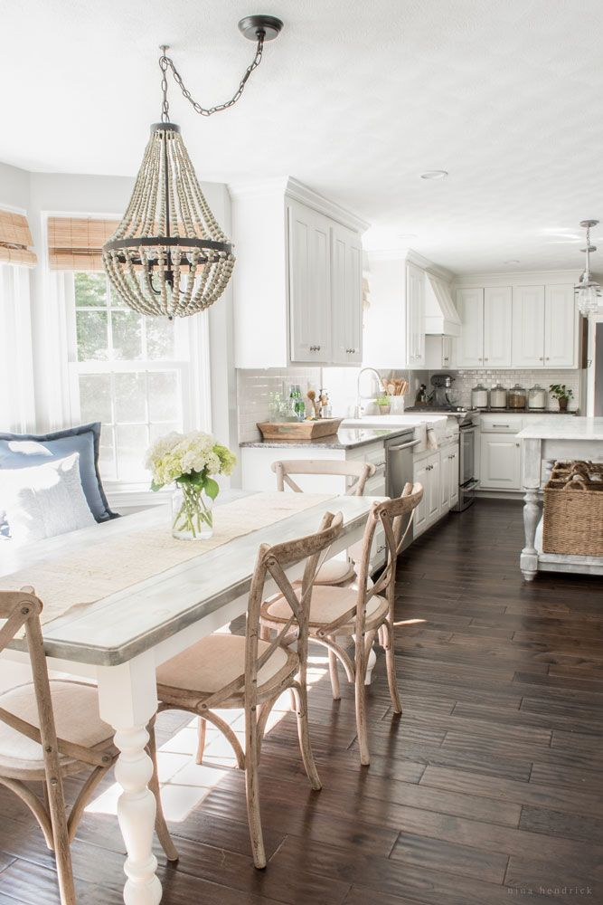Farmhouse kitchen - love the mismatched furniture and beaded chandelier eclecticallyvintage.com