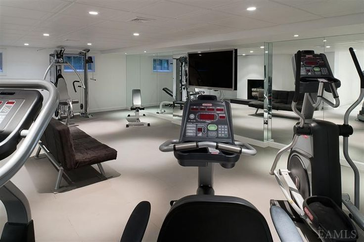 Nice Sized In Home Gym Big Mirror On The Wall With Huge Flat Screen Tv Plenty Of Machines To Work Out On Luxury Amenities North Salem At Home Gym