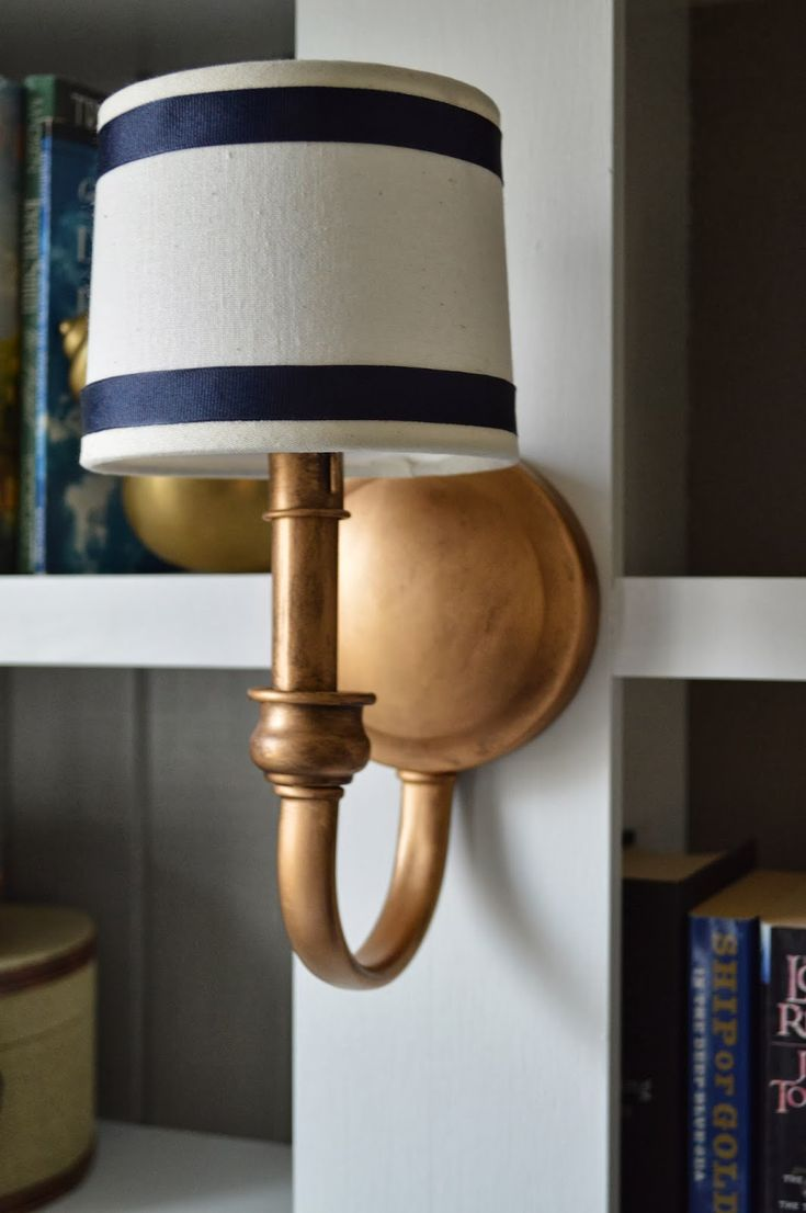 I discovered Rub N' Buff!      BEFORE    I loved the look of the sconces this way too, but really did want a gold-ish/copper color, tha...