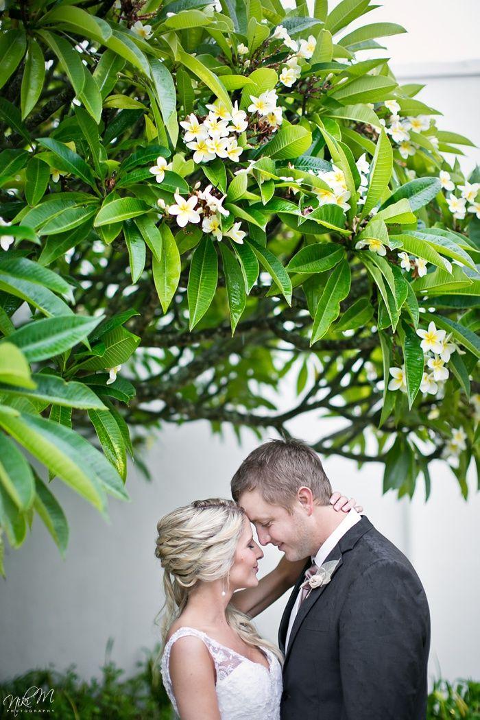 Rainy wedding photos under a frangipani tree Niki M photography