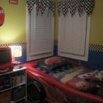 cars bedroom decorating ideas.  I like the checked flag window treatments.
