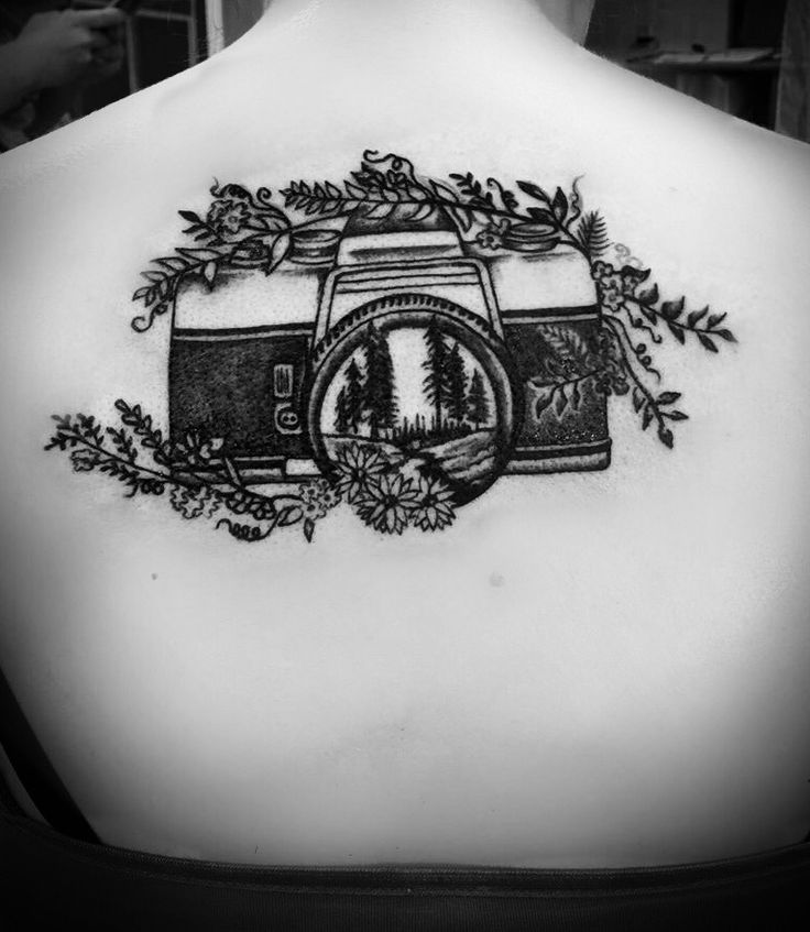 Nature camera tattoo.  Camera, outdoors, tree scene, back tattoo, photographer