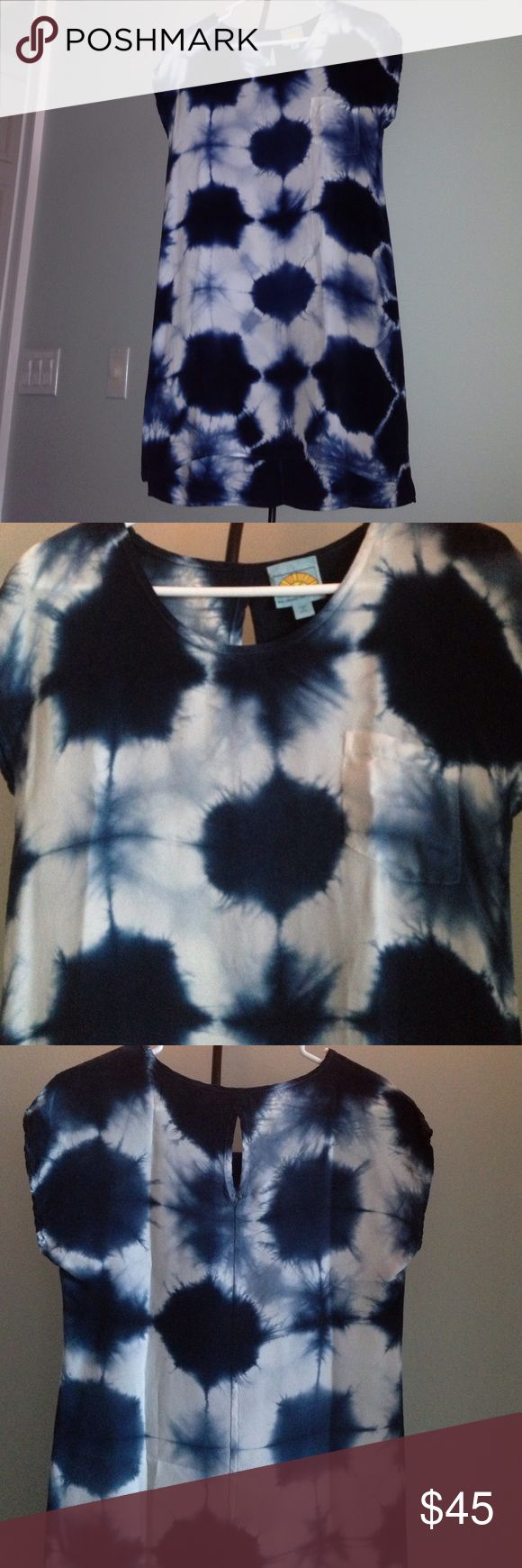 """C & C California Tie Dye Tee Shirt Dress Details: This royal blue tie-dye beauty is made from a fabric called """"Cupro-Bemberg.""""  This high-quality fabric produced in Japan is breathable, light, durable, and with a silky touch that looks and feels great.  Bemberg is made from cotton that has the advantage of wicking sweat and humidity away from the body. It has a left front pocket and a key-whole opening in the  back. Size: XS Measurements:  31"""" from top to bottom of hem in front; 35"""" in back…"""