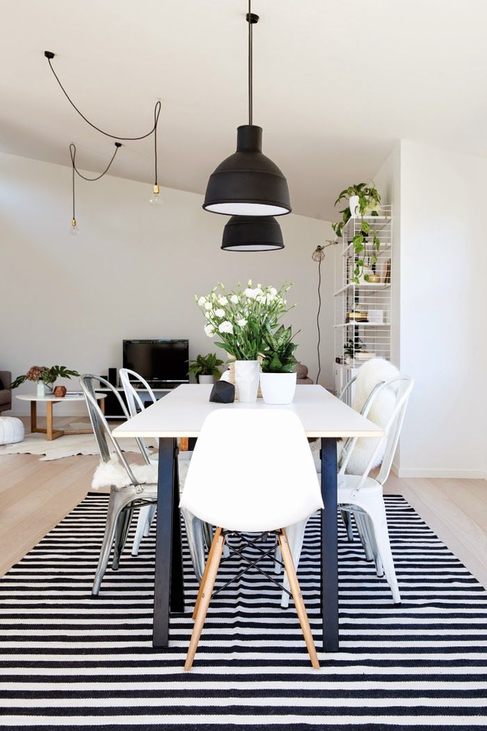 Black industrial lamps, black and white striped rug, black and white dining room, eames chairs. Photo: Larnie Nicolson