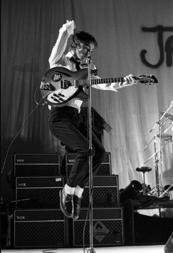 Fin Costello - Paul Weller performing live onstage, with The Jam at the Hammersmith Odeon, December 1977.