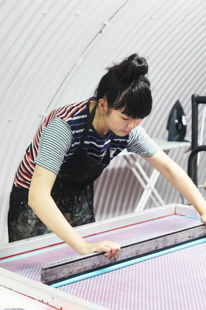 There's something so genuine about screen printed fabric. The process seems so intricate and yet so massive. I bet that squeegee is at least 2 feet long. #screenprinting