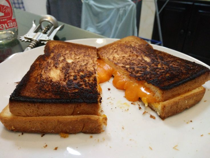 Weak flip game but a strong melt. Red Leicester on white. #grilledcheese #food #yum #foodporn #cheese #sandwich #recipe #lunch #foodie