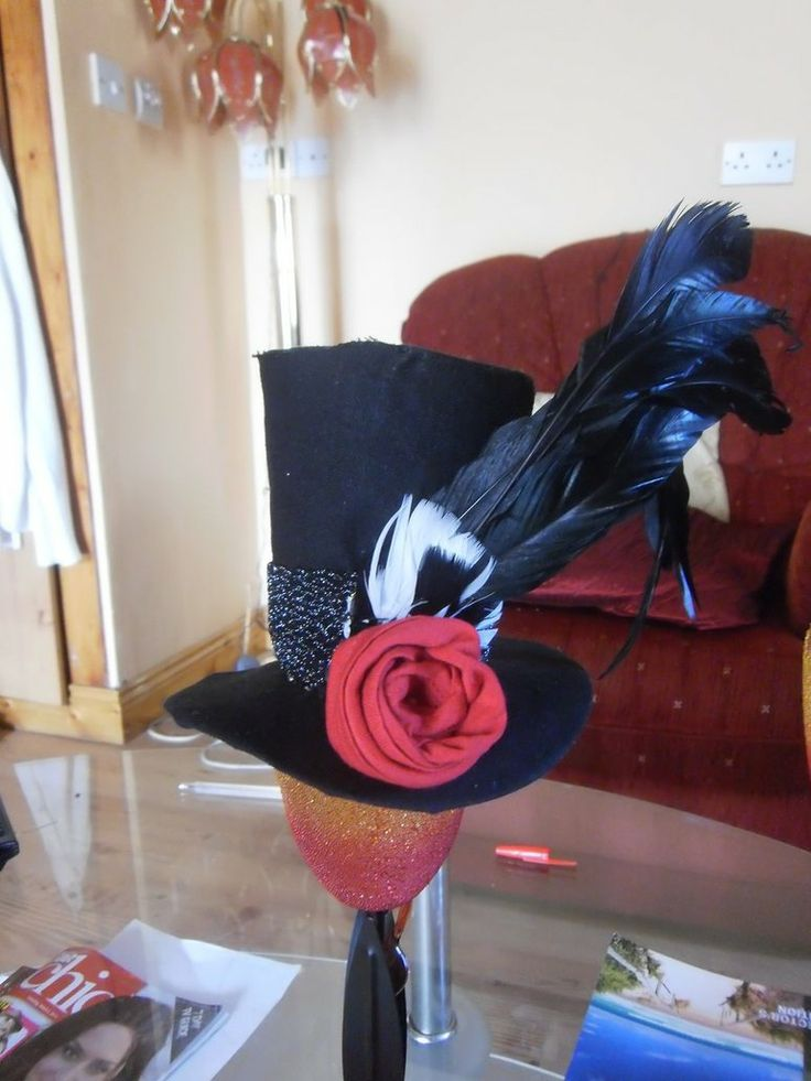 Black mini top hat with feather and rose for college ball
