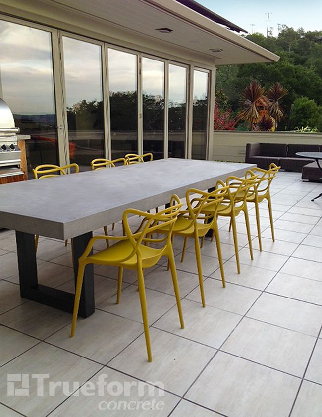 This is a Zen Outdoor Concrete Table with a powder coated steel table base. #Concrete #Tables & Table Tops -Trueform Concrete Custom Work