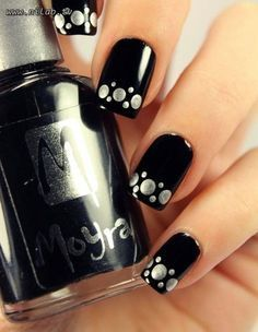 Beautiful polka dot nail art on black base