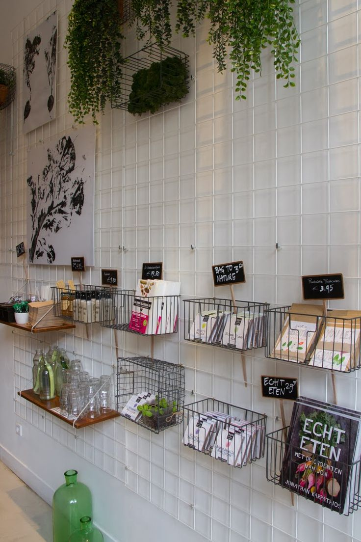 Use grid concept usually found in retail in a small space to maximize storage and organization. Brilliant!