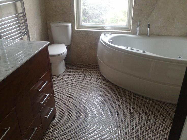 Bathroom with curved corner bath tub