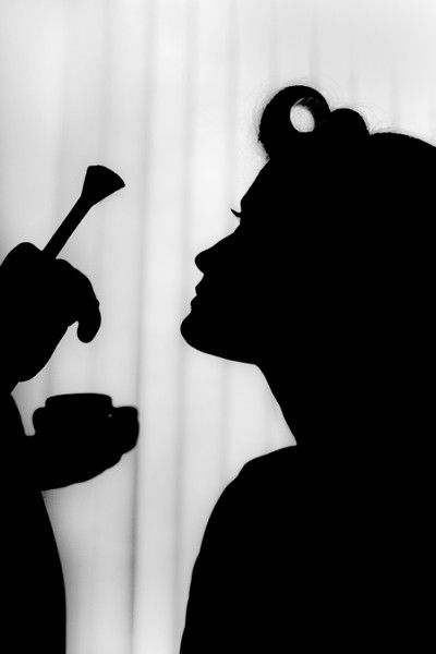 Silhouette Wedding Photos: An amazing image of the bride preparing for her wedding day.