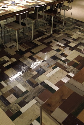 Cool use of upcycling old wood to make a wood floor