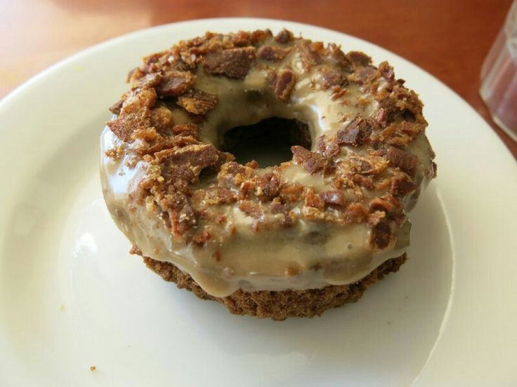 """Bacon Doughnut  Image Credit  There are those that believe that """"everything is better with bacon,"""" and this unique dessert idea seems custom made for them. Since combining something that tastes sweet with something salty is not at all out-of-the-ordinary, this might actually work. You'll never know until you try."""