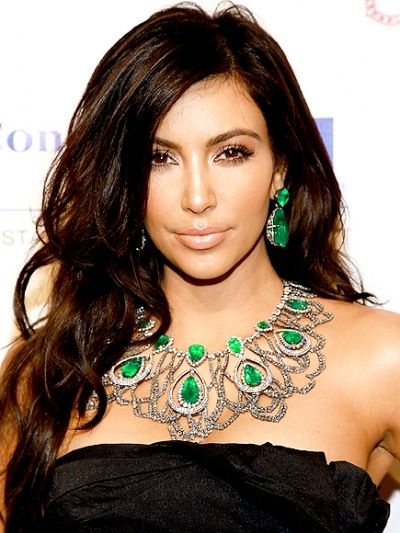 Kim Kardashian rocking the large emeralds in her necklace and earrings from her personal collection.  This gem color suites her and with her larger than life lifestyle she can pull this off.  It's a very Liz Taylor suite of jewelry. (Why don't they ever smile in these pictures?)