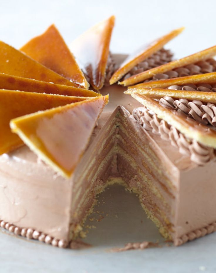 Dobos torte or Dobosh is a Hungarian cake named after its inventor, a well-known Hungarian confectioner, József C. Dobos (1847–1924) in 1884. It is a five-layer sponge cake, layered with chocolate buttercream and topped with thin caramel slices. The sides of the cake are sometimes coated with ground hazelnuts, chestnuts, walnuts or almonds but the original cake is uncoated, since it was a slice of a big cake. Dobos' aim was to make a cake that would last longer than other pastries.