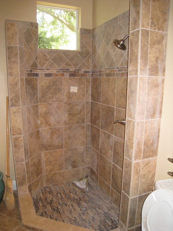 Natural stone corner shower by the Home Improvement Source