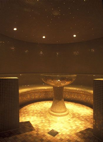 Deluxe tiled steam room with iridescent mosaic tiles