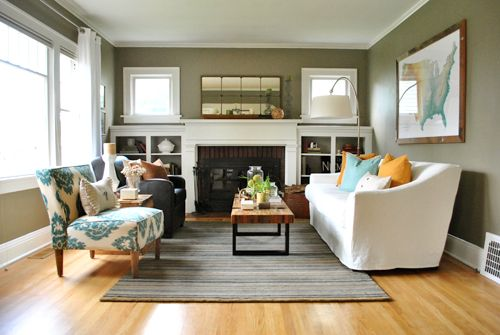 """I love pretty much everything about this room and rest of the house. This was a """"house crash"""" from Young House Love. My favs about this room is the colors, mirror, and C coffee table.  See rest of rooms via attached link......"""