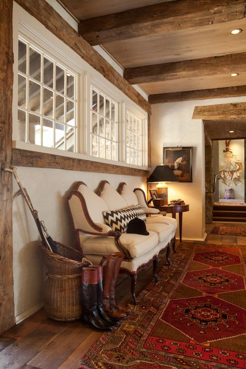 North Carolina equestrian style. Kate Jackson Design--love the rug, basket, the exposed beams, the wooded siding, and the couch...Oh! and the boots. Gotta love a good pair of riding boots.: