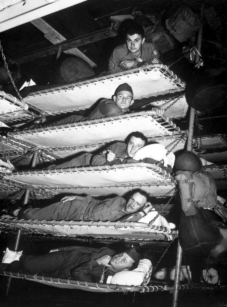 Shipboard life, WW2: GIs in bunks on the U.S. Army transport SS Pennant on November 1st, 1942. Not good for those suffering from claustrophobia or sea sickness.