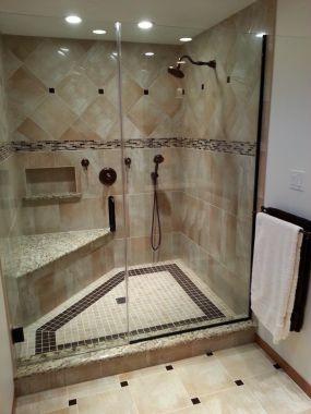 polished porcelain tile with glass accents throughout shower design oilrubbed bronze fixtures brings replacement shower