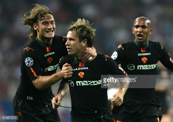 Roma's Antonio Cassano celebrates his goal against Real Madrid with team mates Francesco Totti and French Olivier Dacourt during their Group B...