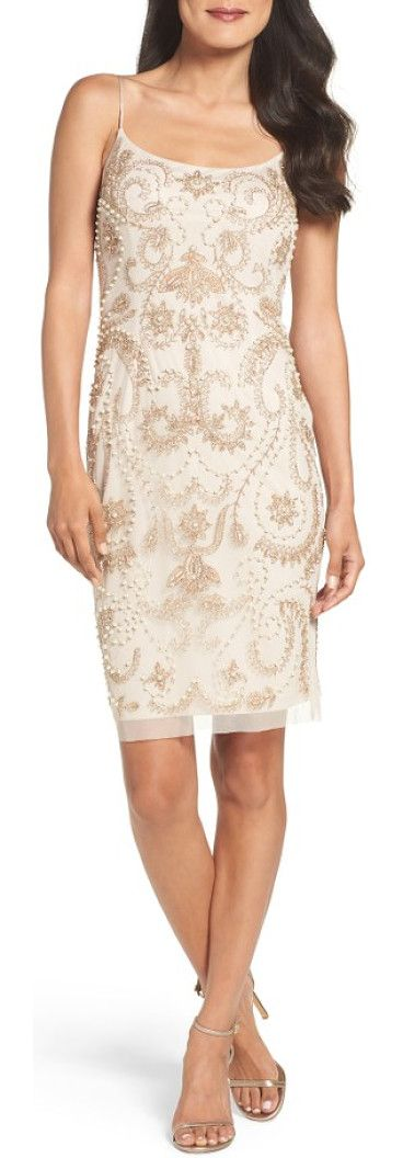 embellished sheath dress by Adrianna Papell. Neutral beading, sequins and faux pearls envelop this slinky, mesh cocktail dress fitted with princess seams.