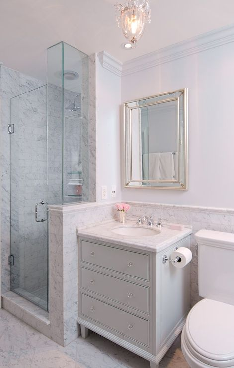 Sophisticated Bathroom Features Silver Beveled Mirror Over Grey Vanity Paired With White Marble