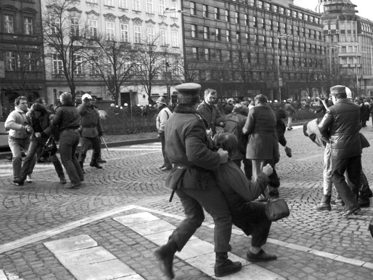 """Police detain protesters on January 15, 1989, 20 years after Palach's suicide. Demonstrations in his honor escalated into what would be known as """"Palach Week,"""" mass protests against Czechoslovakia's communist regime. The rallies were crucial in mobilizing support for the anticommunist protests of the Velvet Revolution later the same year."""