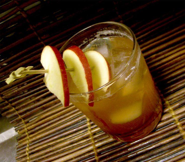 """Winds of Fall"" (would be cute in a mason jar): bourbon, lemon juice, maple syrup, apple juice, campari, honey, & apple slices."