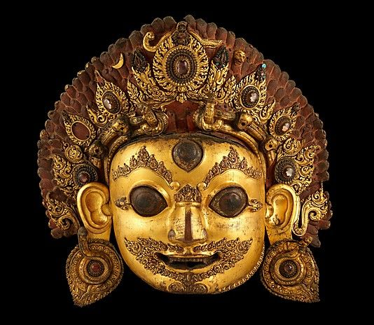Head of Bhairava, the Wrathful Form of Shiva. Nepal, 16th century. Gilt copper with rock crystal and paint, h. cm. 81.3. New York, The Metropolitan Museum.