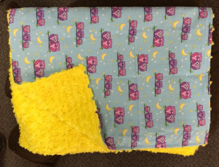 blue and pink owls with yellow rose on the back. small blanket for travel or in the stroller.