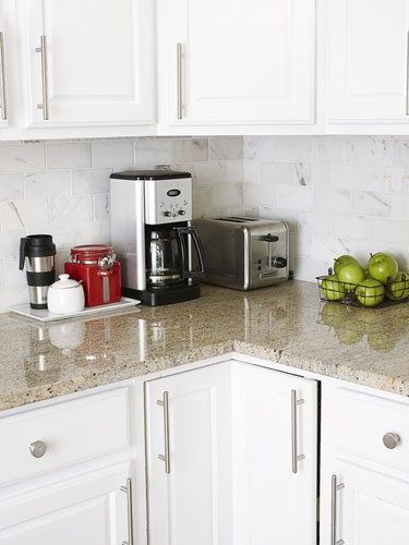 """(I love the tray/caddy idea for Mike and my coffee crap!) """"If you reach for an item a few times a week, it belongs on the counter. Everything else goes in a cabinet."""" If you're like us and need caffeine in the a.m., put the coffeemaker and a tray with grinds, creamer and sugar etc. If you have a corner, tuck your all-the-time items there to avoid wasted space."""