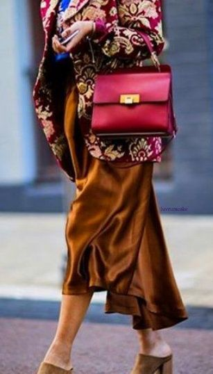 Balenciaga handbag & Dolce and Gabbana clothing