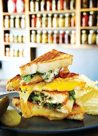 Reason to Love Toronto #2: Grilled Cheese restaurant, Kensington Market : the grilled motzy (fior di latte, sun-dried tomatoes, pesto, arugula and balsamic vinaigrette), all served with a crisp dill pickle and a side of salty chips.