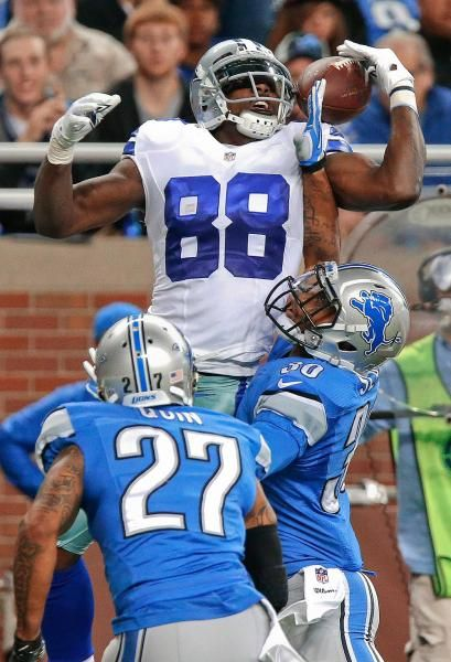 Dallas Cowboys wide receiver Dez Bryant (88) catches a 5-yard touchdown reception as Detroit Lions cornerback Darius Slay (30) defends and Glover Quin