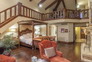 Mediterranean Master Bedroom with Balcony, Hardwood floors, metal fireplace, High ceiling, Ceiling fan