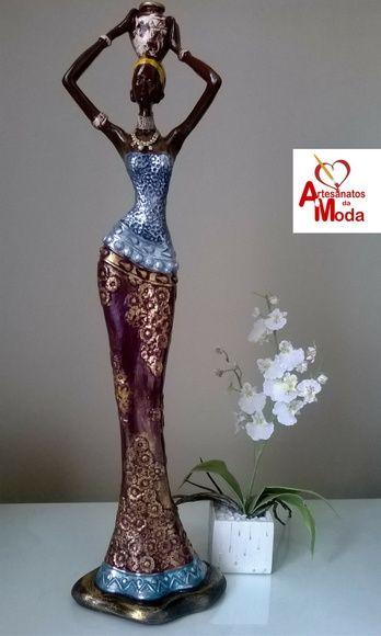 Estátua decorativa    Africana    Gesso    Altura: 50cm    Largura: 14cm